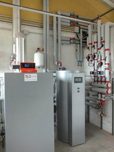 Centrale termica per riscaldamento e produzione ACS con caldaia a pellet e solare termico per laboratorio artigianale con abitazione annessa - 2