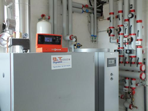 Centrale termica per riscaldamento e produzione ACS con caldaia a pellet e solare termico per laboratorio artigianale con abitazione annessa - 6