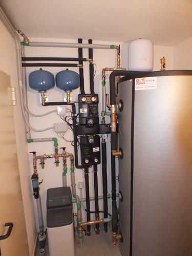 Riqualificazione villa con impianto di riscaldamento e produzione di acqua calda sanitaria con caldaia combinata legna/pellet - 3