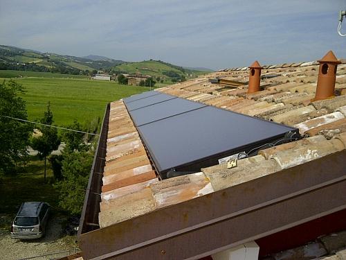 Villa con riscaldamento e produzione di ACS con caldaia a legna e solare termico - 1